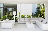 Outdoor living room with white sofa on roofed terrace