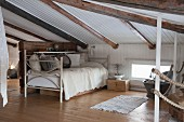 Day bed in low attic room in natural shades