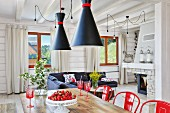 Open interior of white wooden house with red accents
