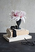 Magnolia flowers in black vase
