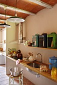 Sink and hob in kitchen worksurface in country-house interior