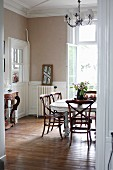 Vintage wooden table and cane chairs in restored dining room