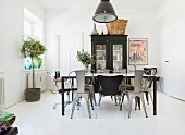 Various chairs around black table in dining room