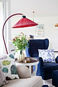 Vintage-style arc lamp with red lampshade in living room
