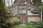 Vintage greenhouse in garden