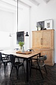 Classic chairs around dining table in renovated period apartment