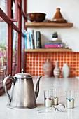 Vintage teapot, tea glasses and tea strainer