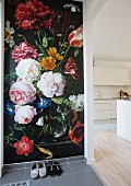 Photographic wallpaper in hall with view into open-plan kitchen
