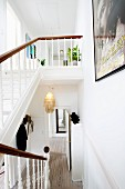 White wooden staircase in restored period apartment