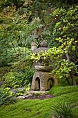 Oriental stone Tōrō lantern in garden