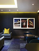 Hotel lounge in shades of dark grey and blue