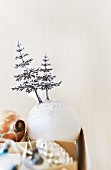 Cut-out Christmas trees stuck on white baubles