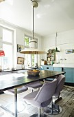Lilac, retro upholstered chairs around dining table in vintage kitchen