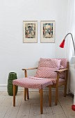 Retro armchair and footstool with red and white patterned covers