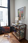 Various collectors' items arranges in glass display case
