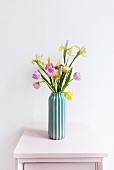 Delicate flowers in turquoise vase