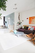 Colourful retro furniture in bright living room with white floor