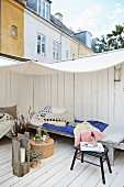 Comfortable wooden terrace below awning