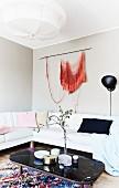 Orange wall-hanging in feminine lounge area