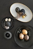 Black and gold Easter eggs on white and black crockery