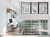 Bright workspace on gallery with modern glass balustrade