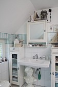 White cabinets and bust in maritime bathroom