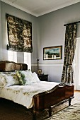 Dark wooden bed and stucco frieze in classic bedroom