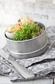 Cress and small snacks in tin
