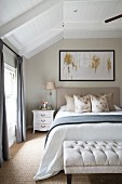 Elegant attic bedroom in shades of cream