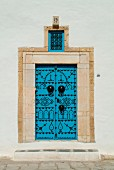 Blue door decorated with black studs, Tunisia