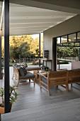Elegant lounge area on roofed modern veranda