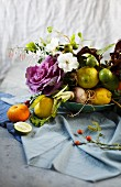Arrangement of flowers, branches, fruit and vegetables