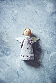 Christmas angel on marble surface