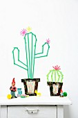 Washi-tape cacti decorating wall