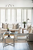 Modern armchairs and white sofas in bright living room