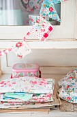 Hand-sewn bunting made from fabric remnants on kitchen dresser