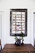 Old window grille in the picture frame as decoration