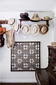 Wardrobe with hat collection over a graphic grid