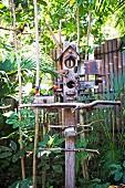 Colorful birds sit on an artistic bird house