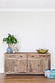Rustic wooden chest of drawers with summery decoration
