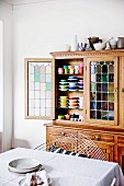 Open kitchen buffet with stained glass and different colored dishes
