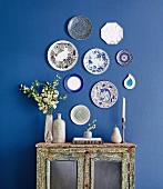 Pretty Plates on a blue painted wall
