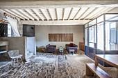 Rustic stone floor in eclectic living area