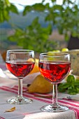 Two glasses of rosé wine on table outdoors