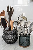 Cutlery and kitchen utensils in ceramic pots