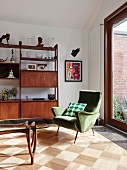 Green armchair in retro living room with parquet floor