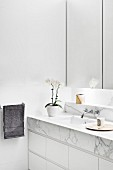 White bathroom with marble vanity top