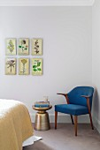 Botanical images over blue retro armchair and side table