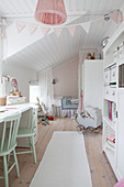 Romantic girl's bedroom with sloping ceiling