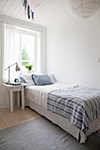 Simple bedroom in white and blue